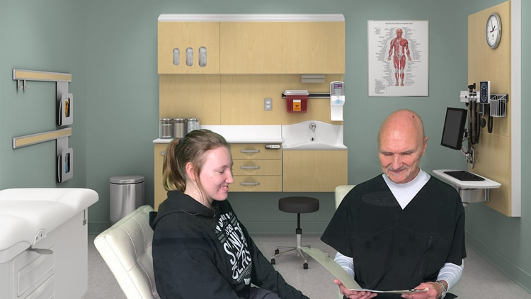 Chiropractor Northfield OH James Krystosik with Young Female Patient